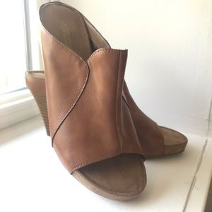 Brown leather open toe bootie style shoe.